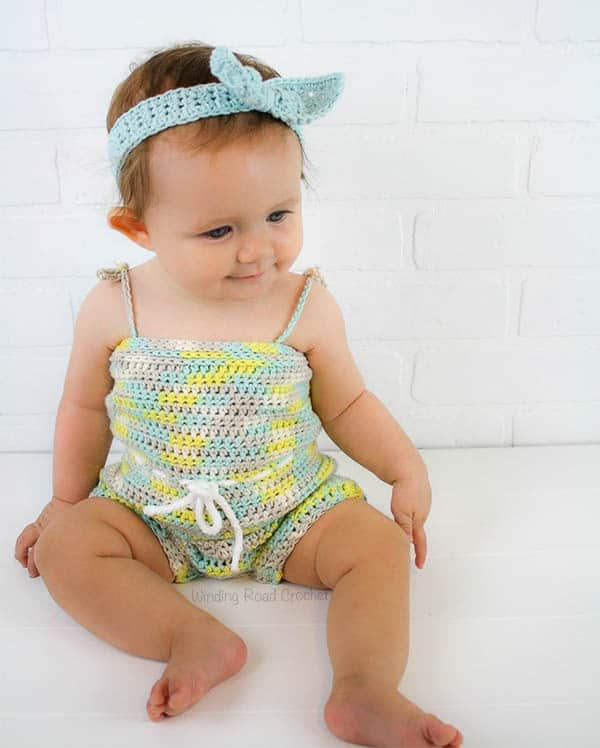 The beachside baby romper is the perfect summer baby shower gift! This quick and easy free crochet pattern was designed for begginers who are comfortable with the basic stitches. This is a beatiful and unique project and with sizes 3 months - 24 months this pattern is great for all baby girls! #crochet #crochetpattern #free #baby #babyromper #babycrochet