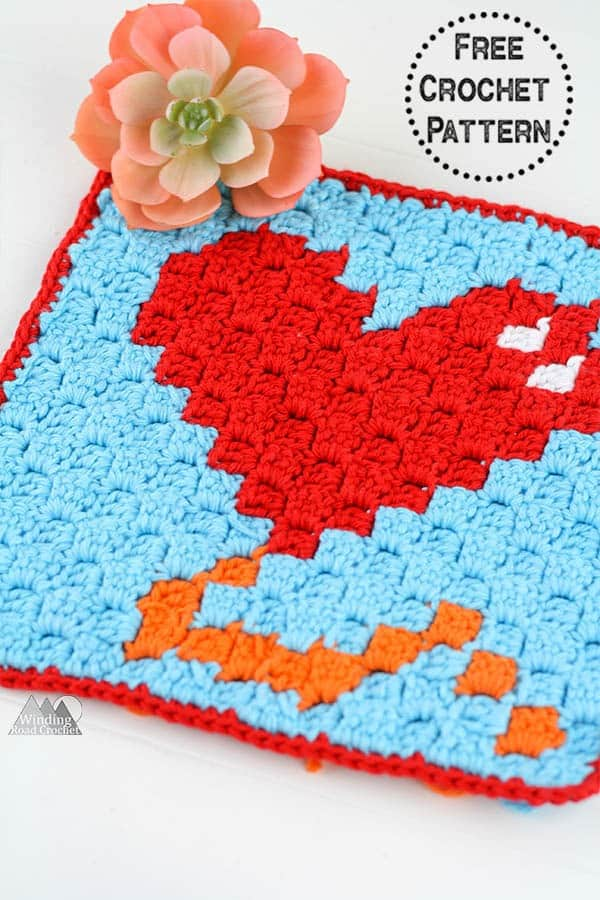 Use the free heart balloon corner to corner crochet graph to crochet a pot holder or washcloth. This pattern is designed for beginners with a written chart and more. #c2ccrochet #cornertocornercrochet