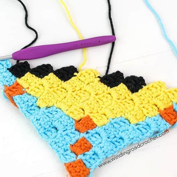 Corner to corner crochet Sun graph and written chart perfect for a washcloth or pot holder. Designed by Winding Road Crochet. #c2c #crochet #cornertocorner #graphgan #crochetgraph