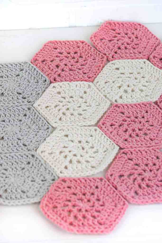 Crochet a beautiful quilt like butterfly baby blanket. This blanket is made with hexagons. Free crochet pattern and video tutorial by Winding Road Crochet.