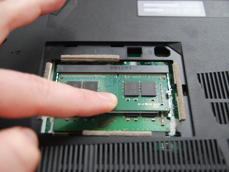 Press down on the stick of RAM.