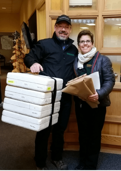 Laurel and Phil at Meals on Wheels representing Crackmasters windshield Edmonton