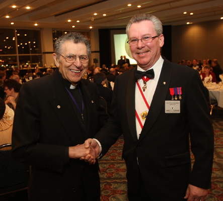 Deacon Ray Mady, left, shakes hands with Knights of Columbus Master  ames Farrand, right,  during the Knights of Columbus 100th anniversary celebration at the St. Clair Centre for the Arts in Windsor, Ont., on Feb., 6, 2010. The Knights of Columbus  council 1453 was the first in Windsor 100 years ago.