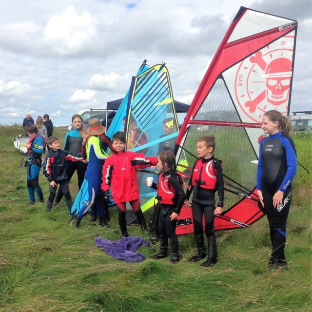 junior windsurfers at a session