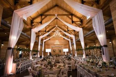 Inside Windy Hill Wedding & Event Barns set up for wedding dinner