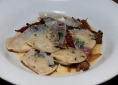 Heritage porchetta, squash blossom, huitlacoche corn ragoût, pearl drop onion