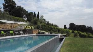 Pool at the Merenda Con Corvi winery / Residenza La Beccata