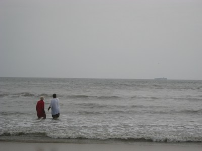 I also loved watching these two gentlemen--I think a son and his elderly father.  The son finally got dad into the water and were rewarded by a close encounter with a pair of dolphins.  They are gazing at where the dolphins just were...about three wave crests directly in front of them.