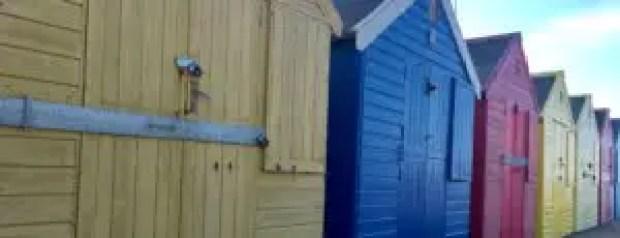 Colourful beach huts along Mundesley Beach, Norfolk