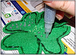 Decorating the clover with glitter glue