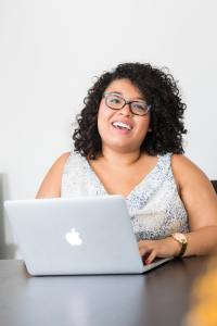 Woman smiling while sitting at computer