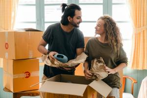 Couple packing cardboard boxes