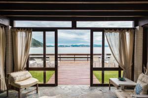 Doors looking onto patio and beach