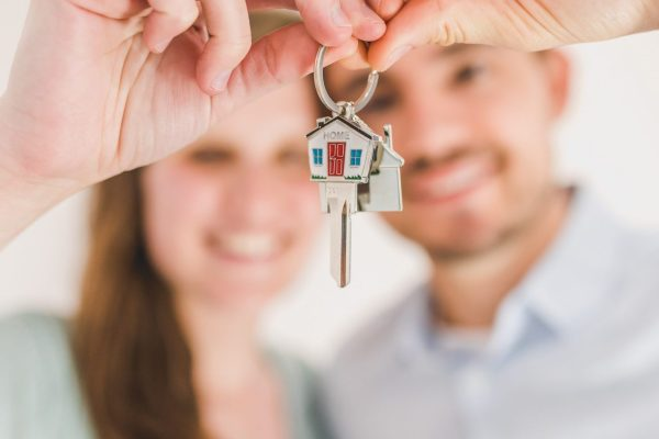 Young couple with house keys