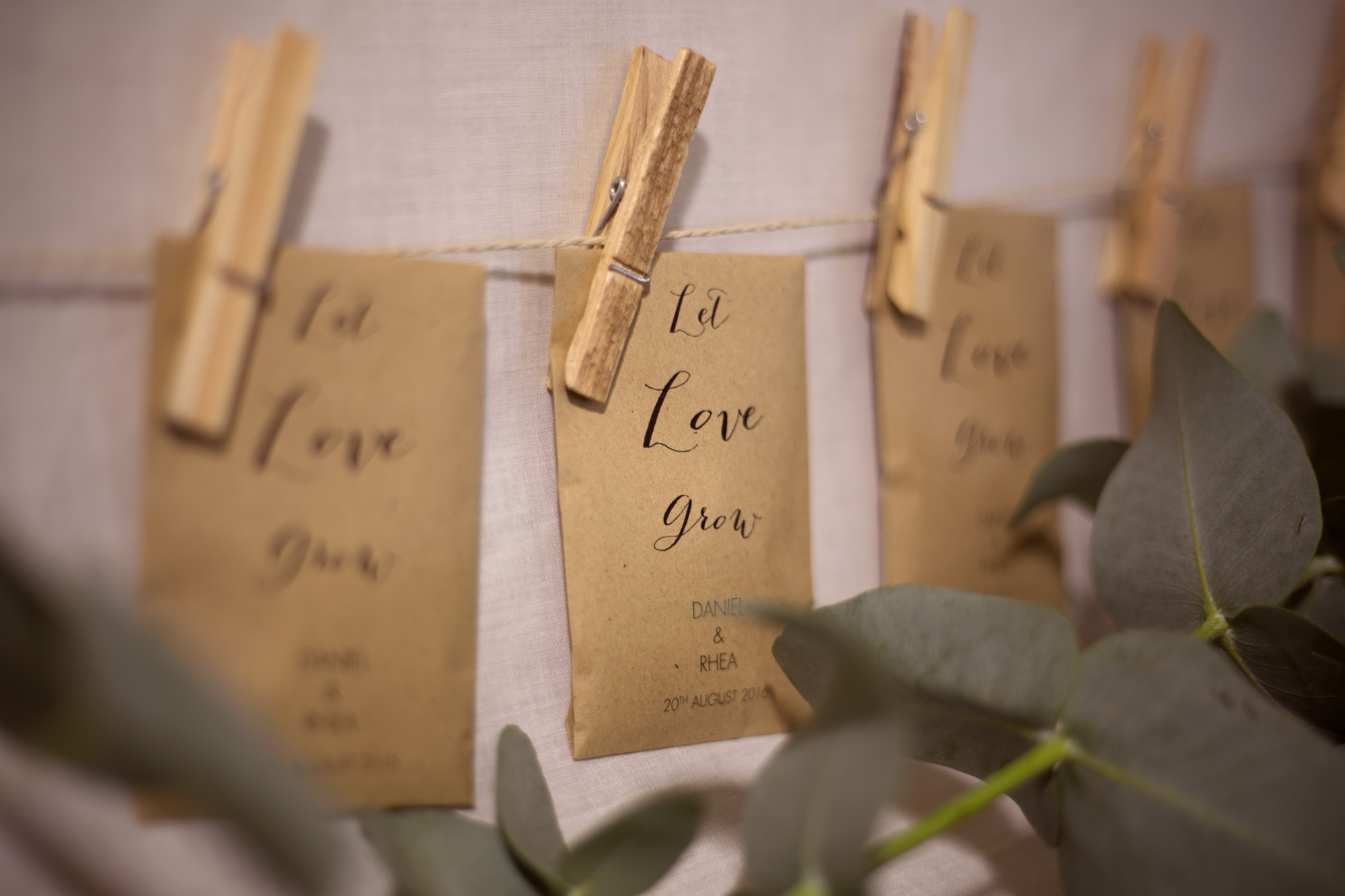 'Let Love grow' seed packets as wedding favours at woodland wedding photographer
