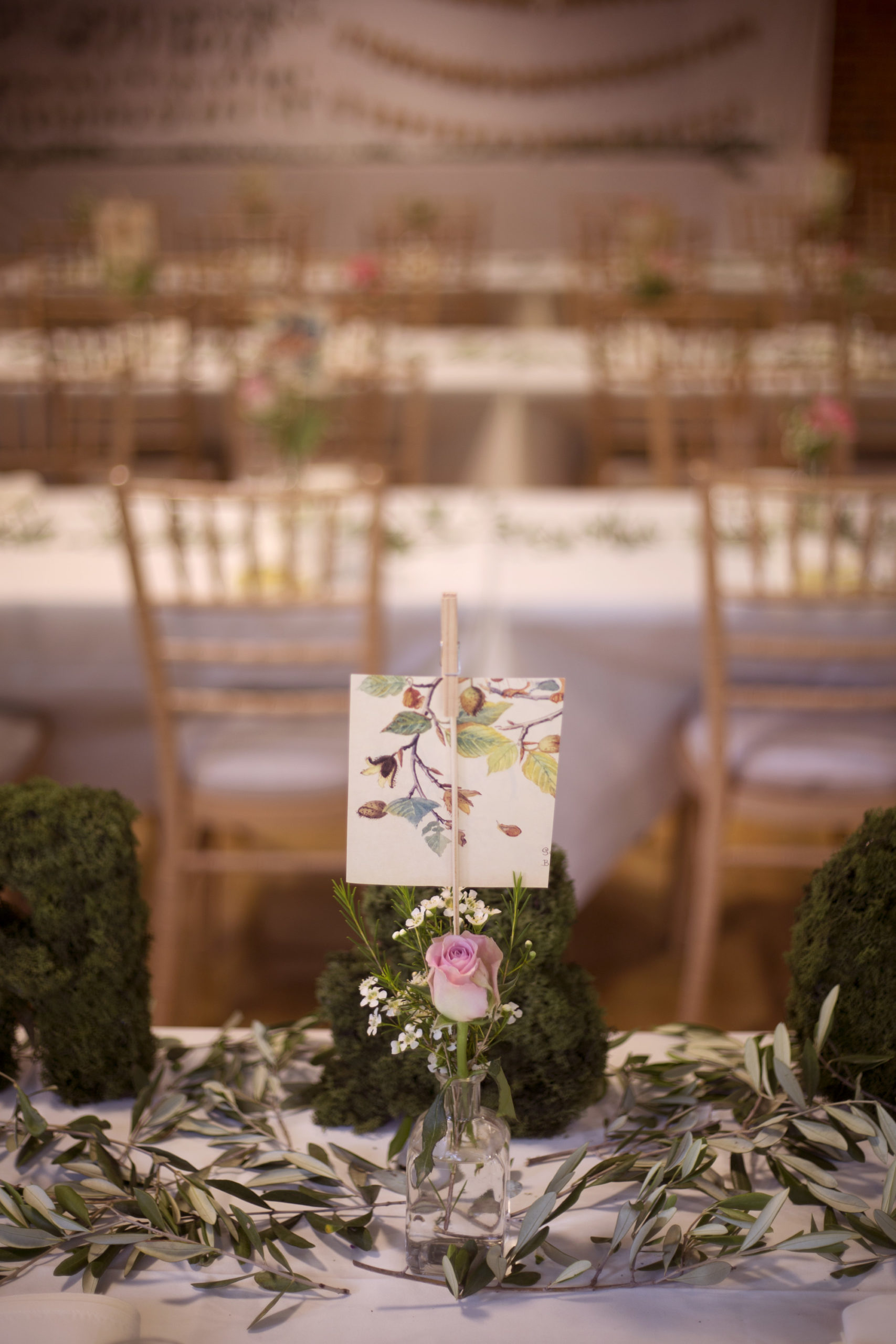 Pink rose and handmade place names on wedding table settings outdoor woodland wedding photographer