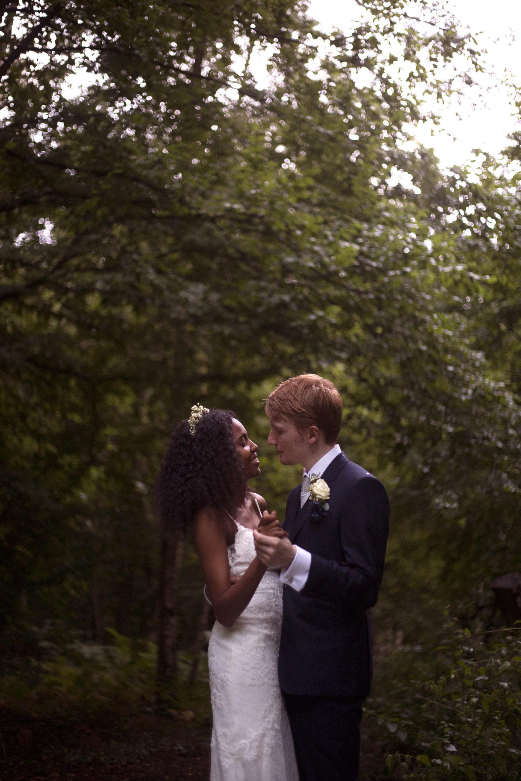 bride and groom slow dance in woodland wedding photographer