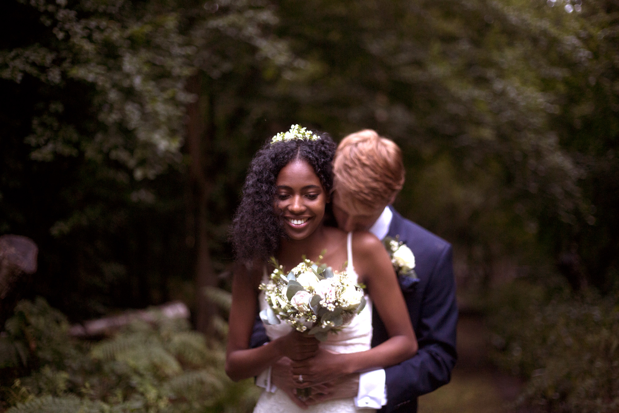 Bride and groom in the forest at Cuffley camp outdoor woodland wedding photographer