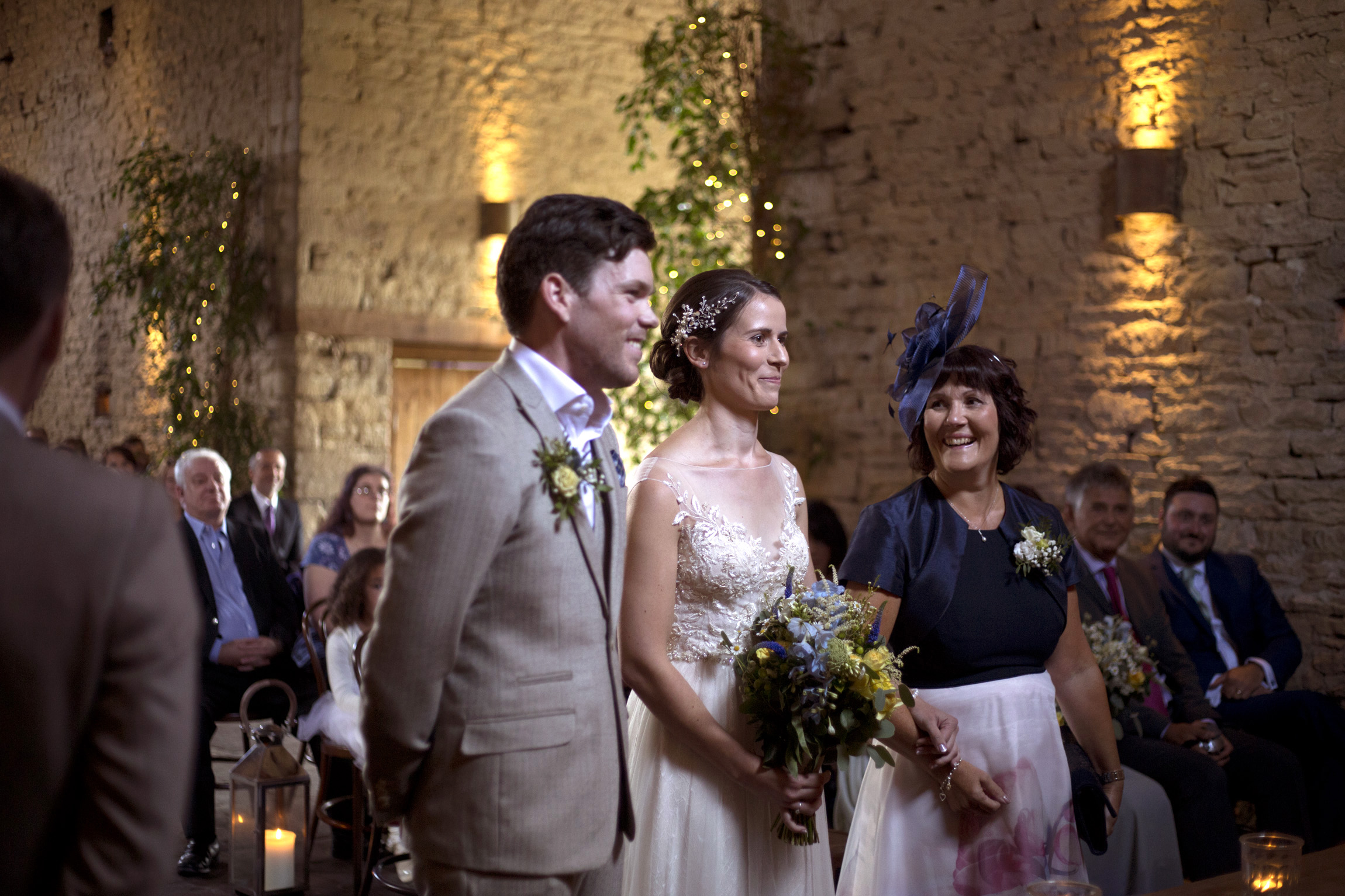 Bride and groom stand making their vows in the ceremony Cripps barn outdoor wedding photographer