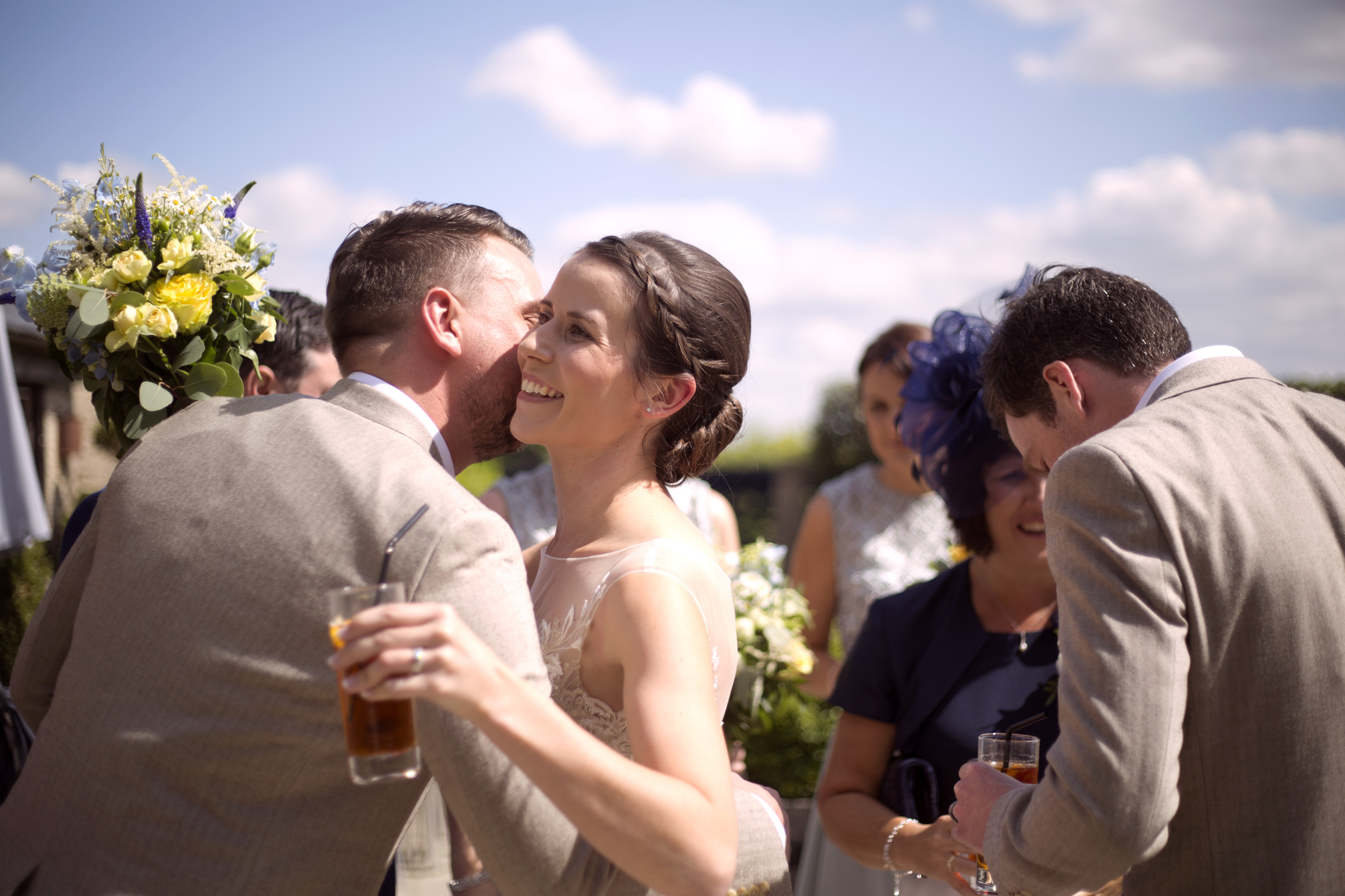 Bride greeting guests after the ceremony Cripps barn outdoor wedding photographer
