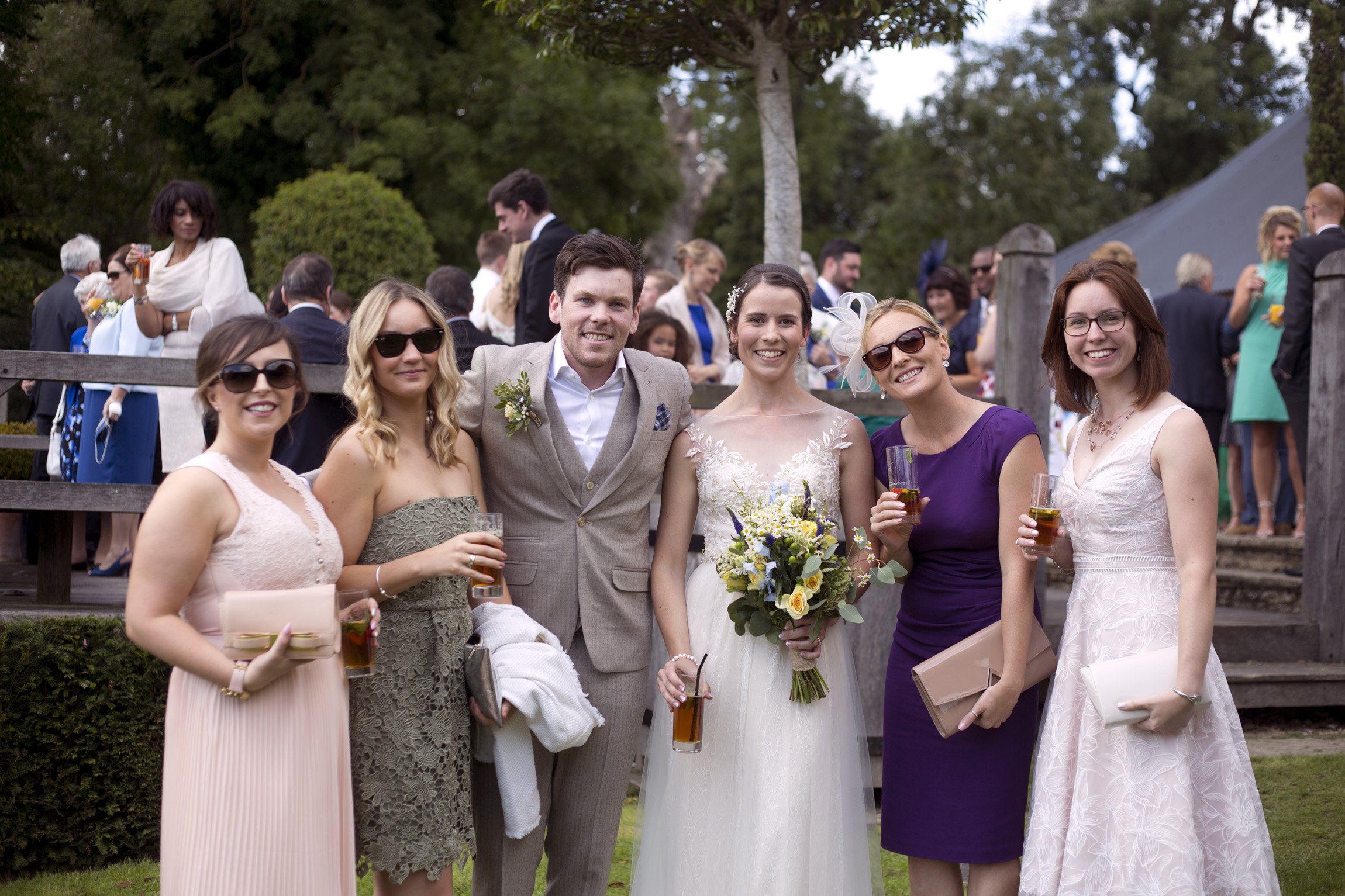 Bride, groom and their guests after ceremony Cripps barn outdoor wedding photographer