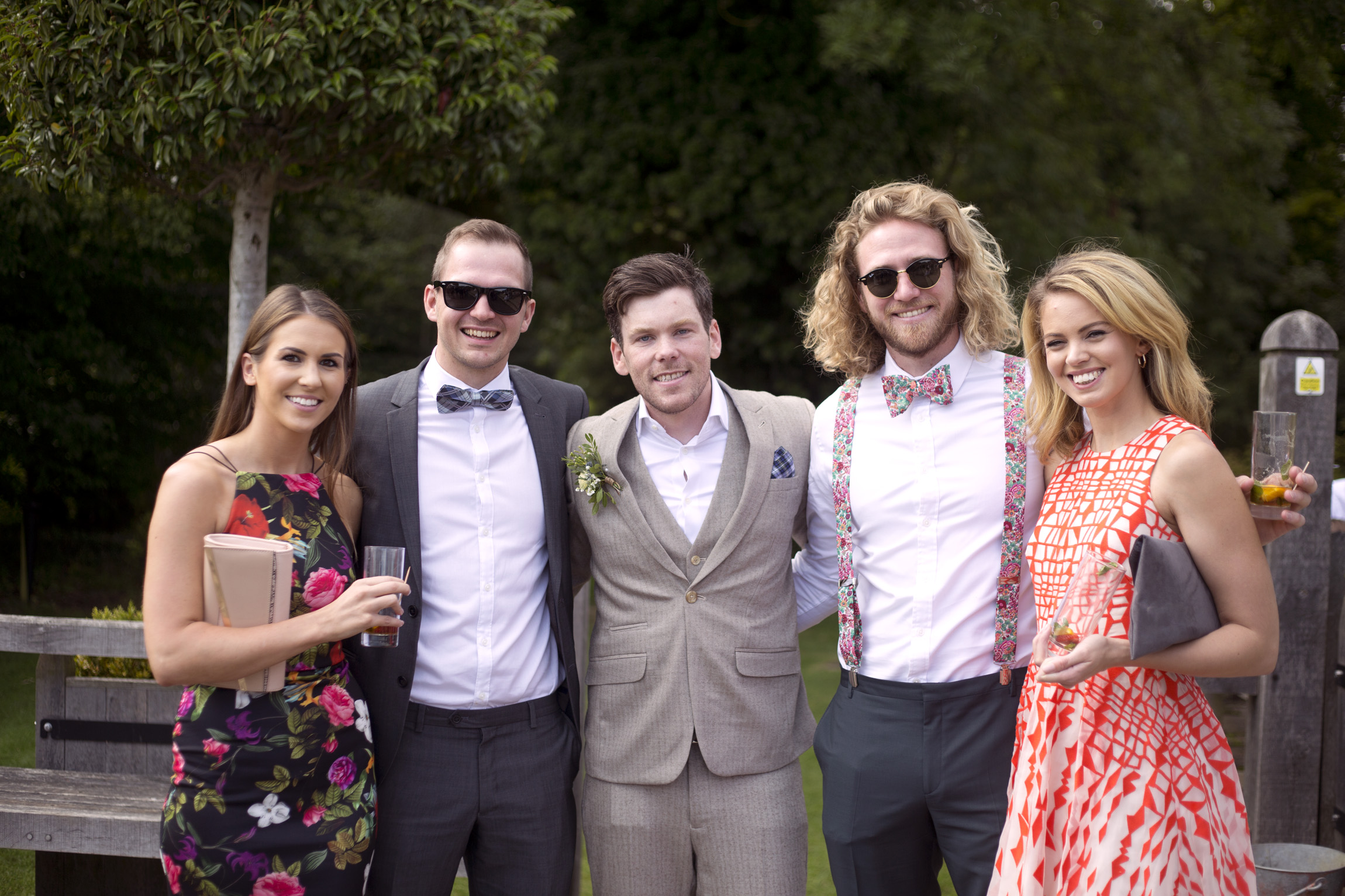 Groom arm in arm with guests Cripps barn outdoor wedding photographer