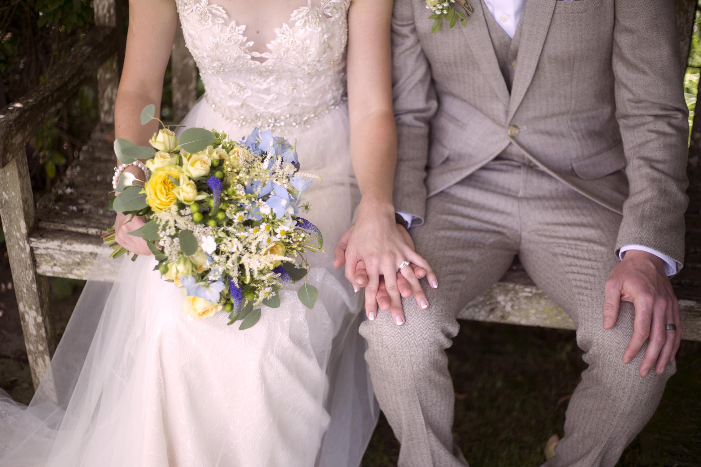 Bride and groom holding hands Cripps barn outdoor wedding photographer