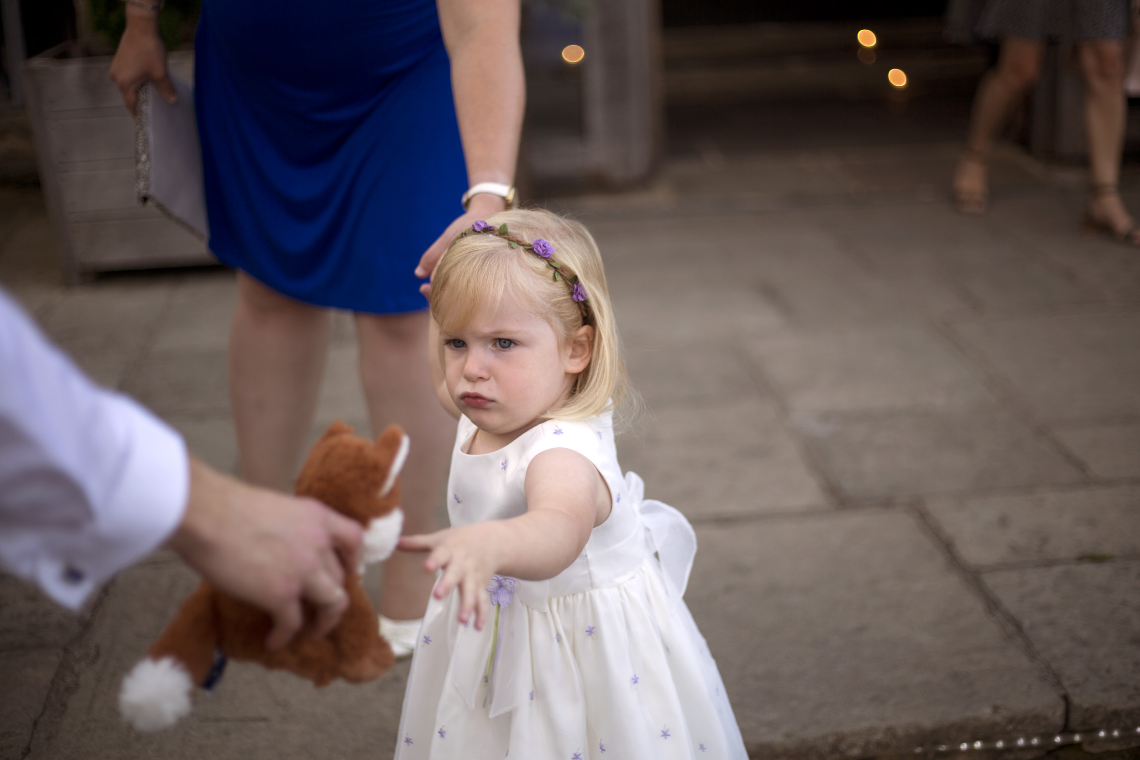 Flower girl wedding guest with her toy Cripps barn outdoor wedding photographer