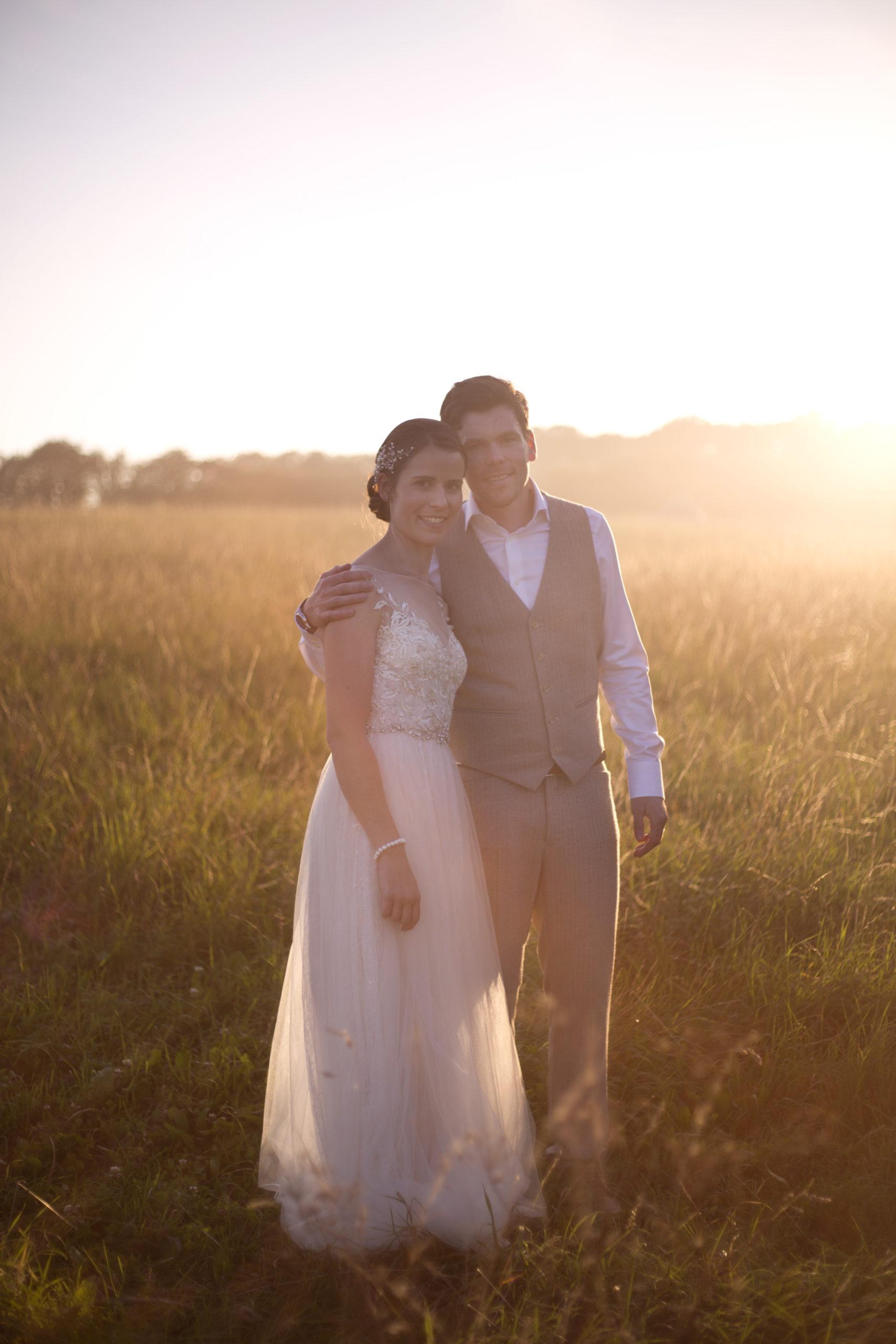 Newlyweds embrace in hazy sunset golden hour photo Cripps barn outdoor wedding photographer