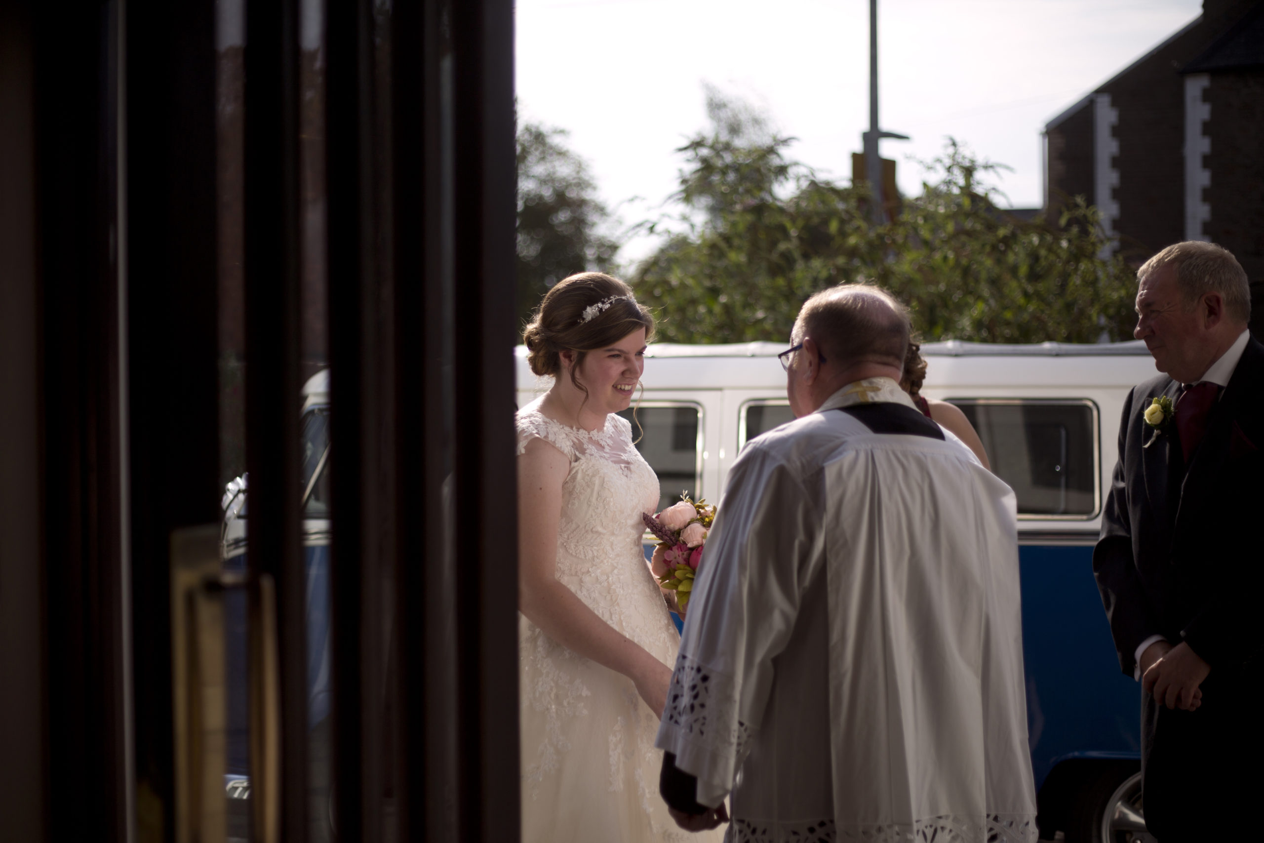 Bride talking to the priest before the ceremony Wedding Photographer St Teilos Church