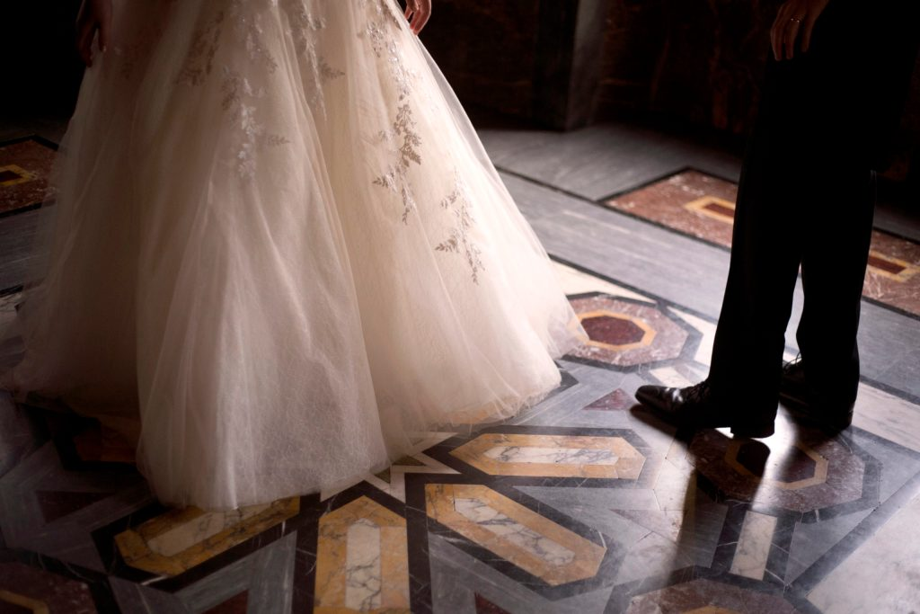 Wedding dress ad groom's shoes with tiles from the Arab room Cardiff Castle Wedding Photographer St Teilos