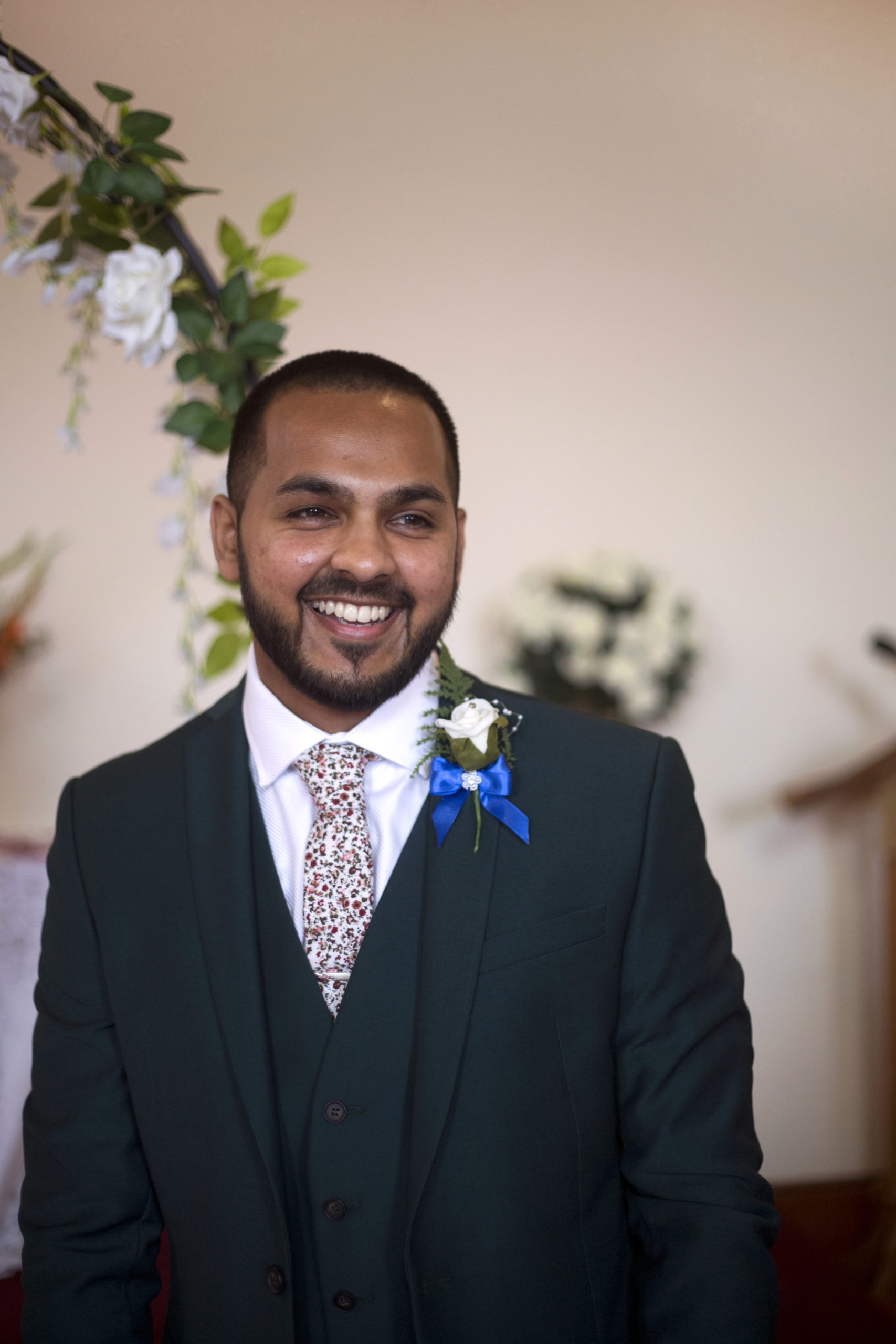 smiling groom before the ceremony micro wedding photographer bristol