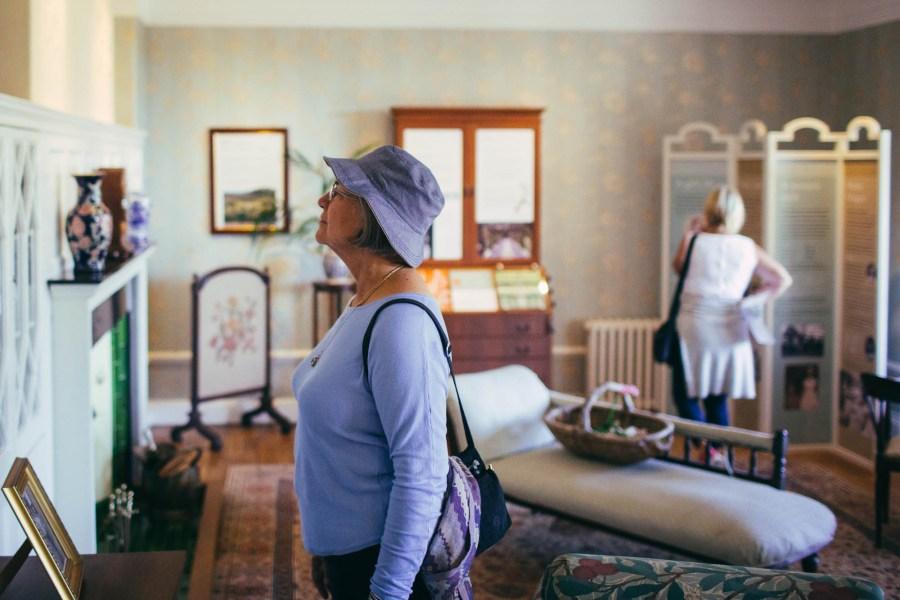 Visitor admiring William Morris wallpaper