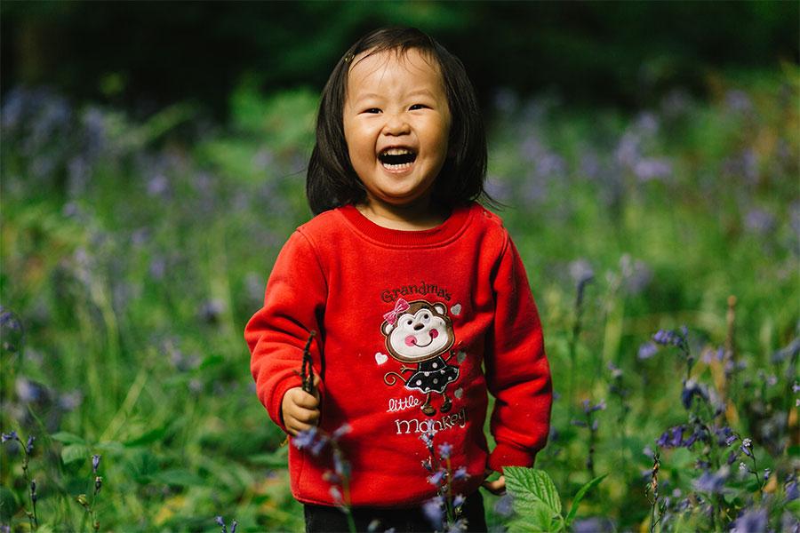 Girl picking flowers in the garden.