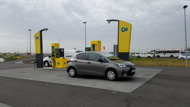 Driving in Iceland - remote petrol station, car in front of pump. No attendants, fuel pump and card reader only.