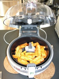 Sweet potatoes, some spices and 1 tablespoon of oil go in the ActiFry.    Photo: Brad Moon