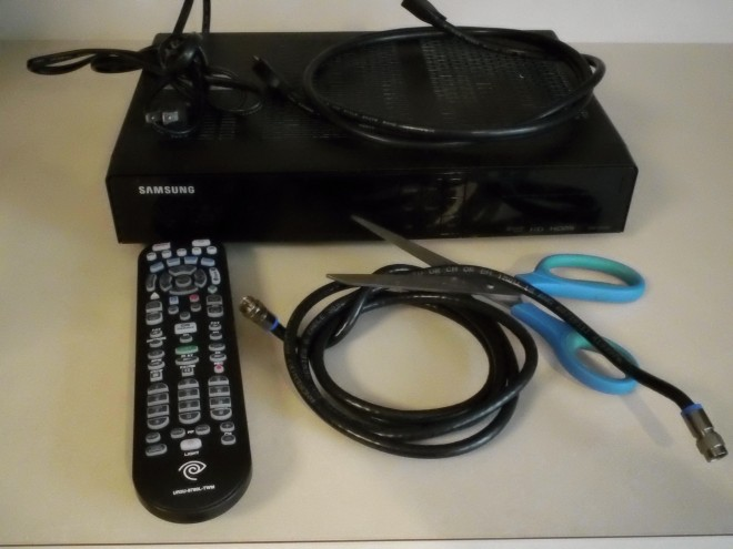 Time Warner remote, cable box, HDMI, coax, and my scissors cutting the cable