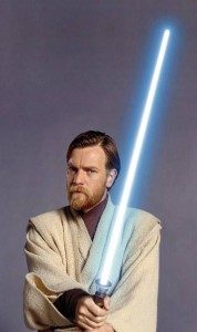 Obi-Wan wearing his Jedi outfit and holding his lightsaber