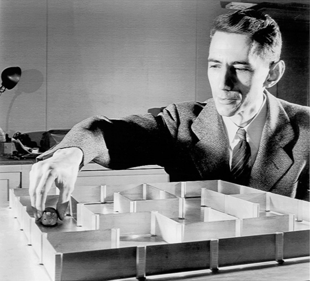 Claude Shannon shows off a robotic mouse
