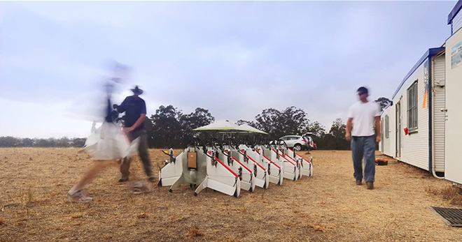 Engineers laying out the drones for testing, in Australia.