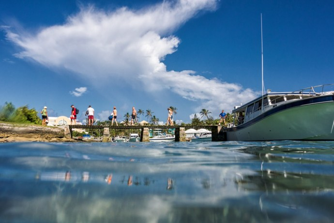 Visitors disembark from a day out on the water at the dock at Flatt's Inlet.