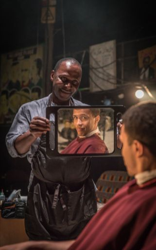 456 Cyril Nri (Emmanuel) Kwami Odoom (Ethan) in Barber Shop Chronicles at the National Theatre (c) Marc Brenner