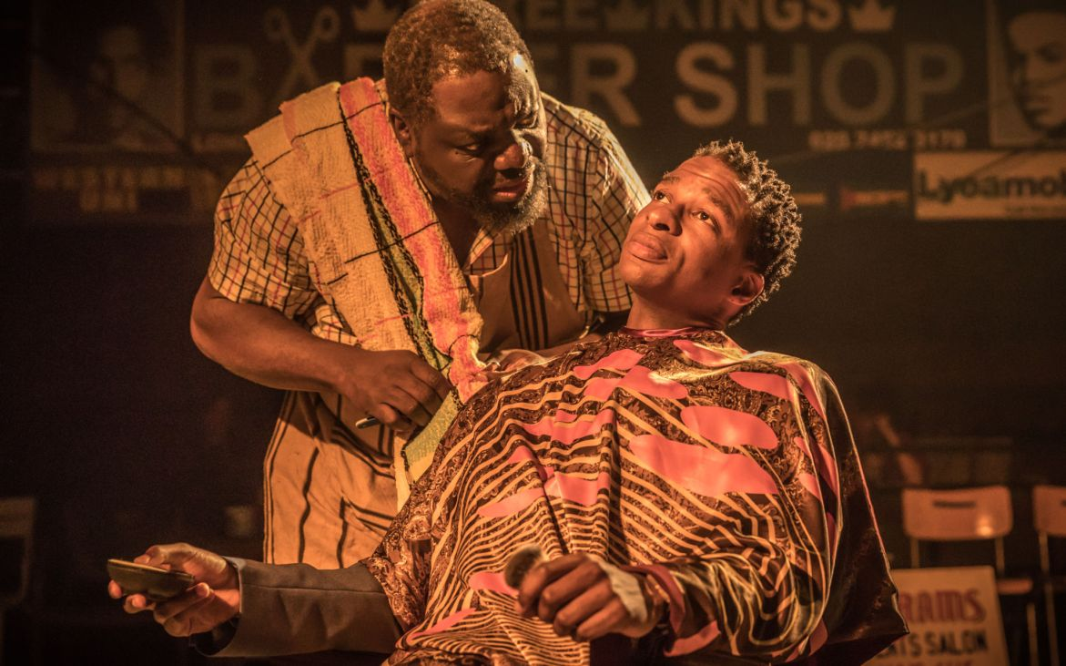 959 Simon Manyonda (Fiifi) and David Webber (Abram) in Barber Shop Chronicles at the National Theatre (c) Marc Brenner