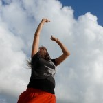 Julia dancing with clouds; workshop in Brittany, France