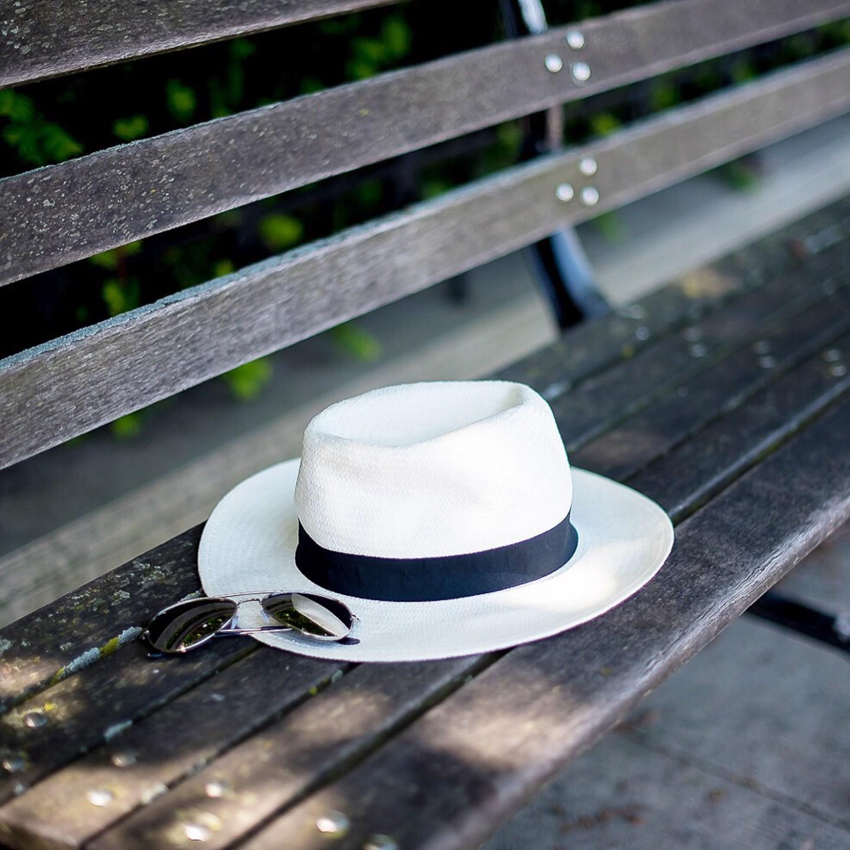 instagram-fedora-and-mirrored-aviators-on-park-bench