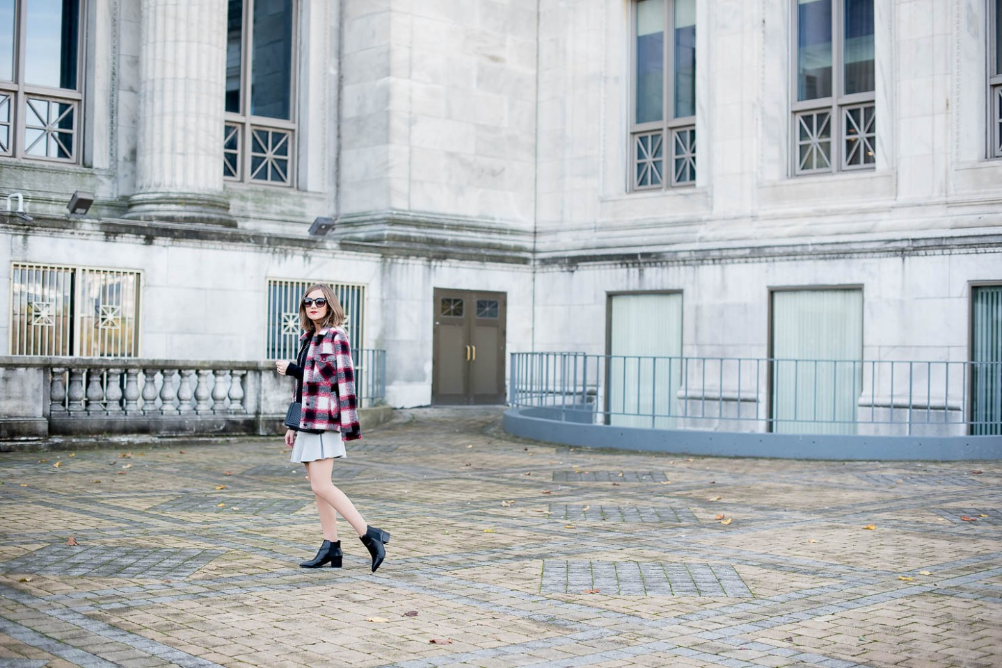 plaid-mens-style-coat-with-a-flared-grey-mini-skirt-red-black-and-grey-outfit-holiday-outfit