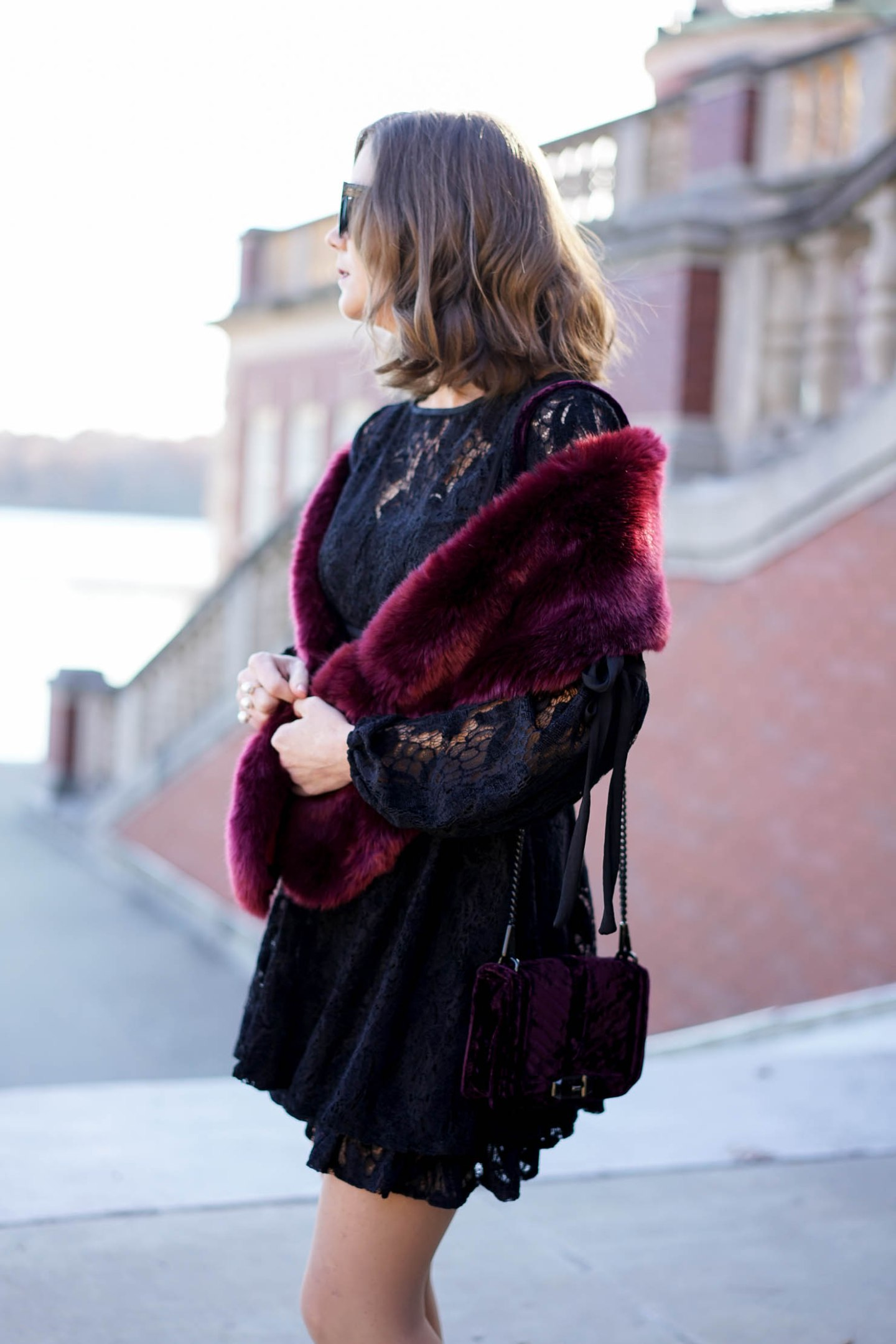Free-People-black-lace-mini-dress-with-long-sleeves-holiday-outfit-dressy-holiday-lookburgundy-faux-fur-wrap-velvet-crossbody-mixing-lace-velvet-and-fur-textures