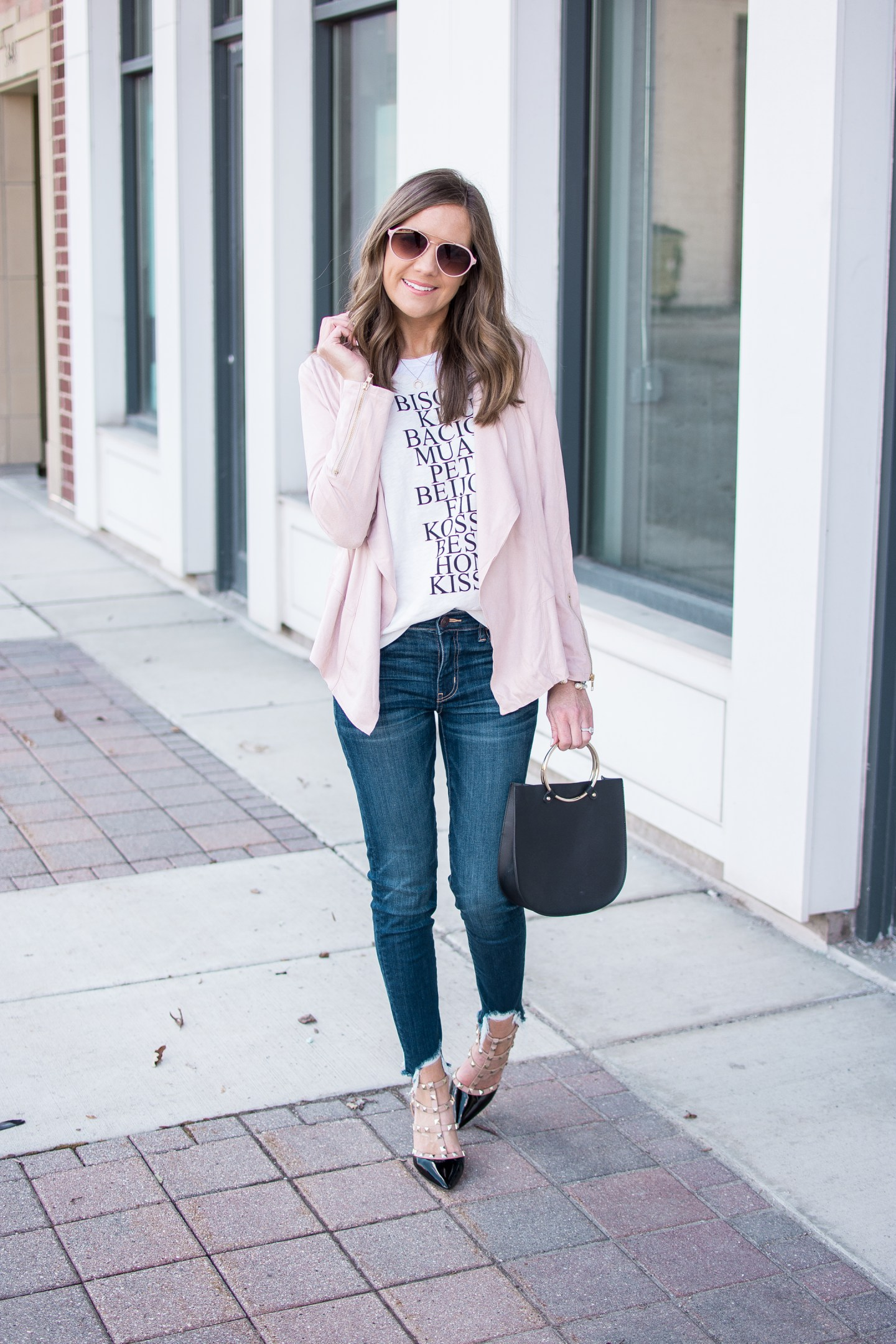 2 ways to style a graphic tee, utility jacket white sneakers, studded pumps