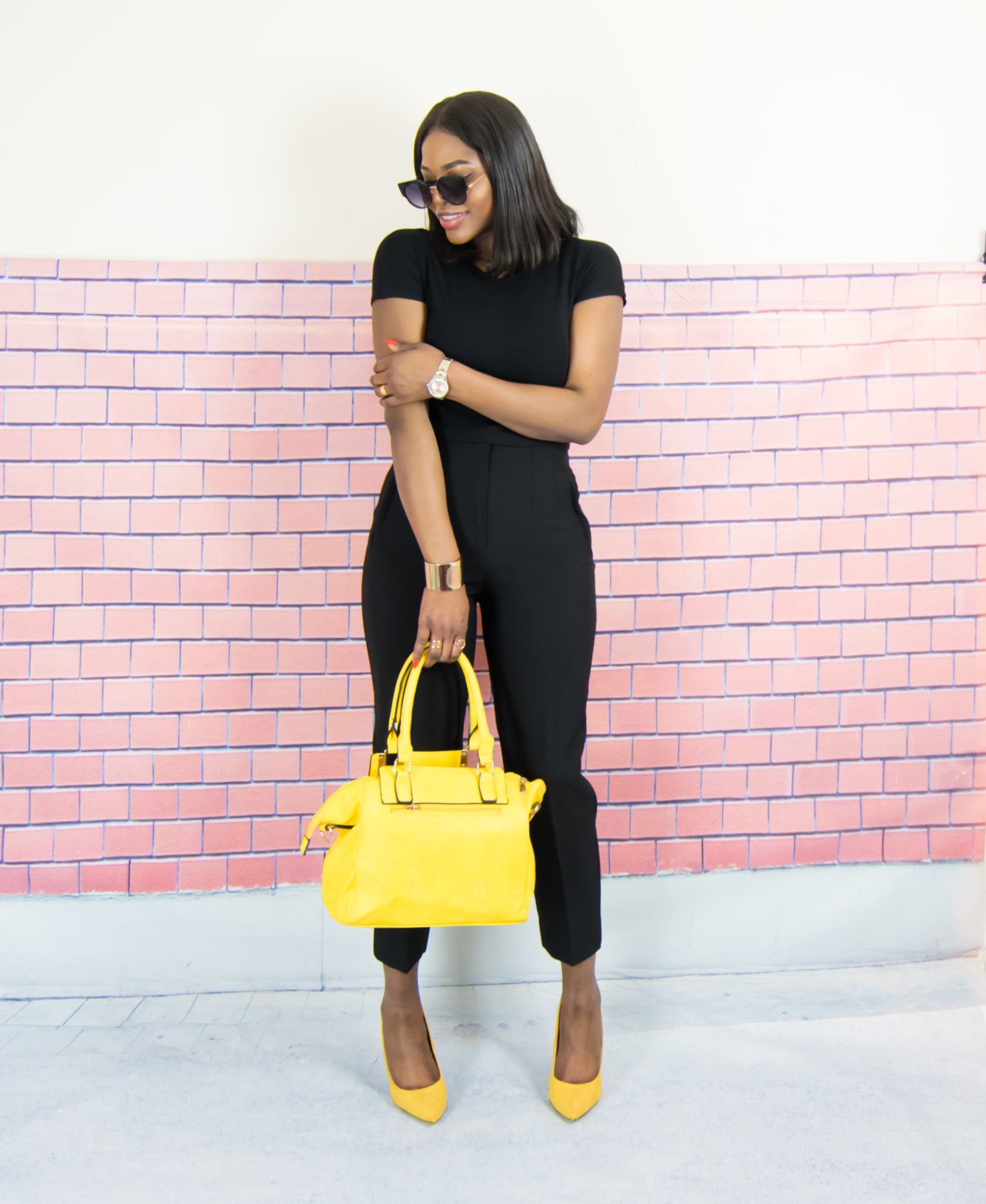 All black outfit + touch of yellow