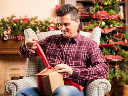 Man opening a gift | Free Photo